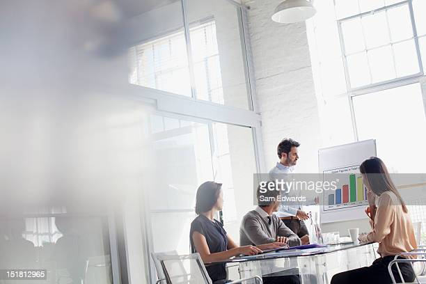 businessman at chart leading meeting in conference room - bar graph stock pictures, royalty-free photos & images