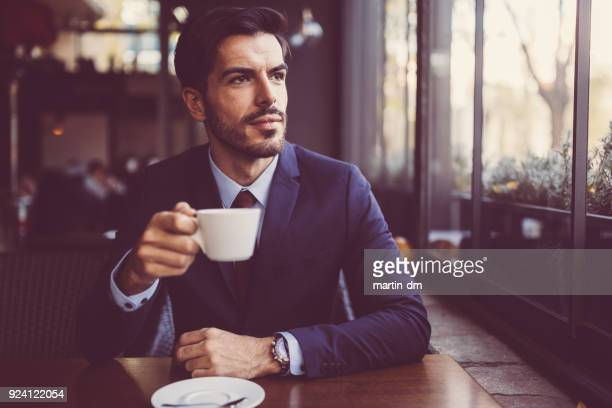 businessman at coffee break - elegance stock pictures, royalty-free photos & images