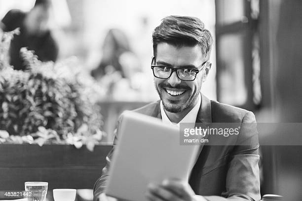 Businessman at coffee break using computer