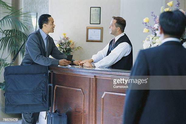 Businessman at concierge desk