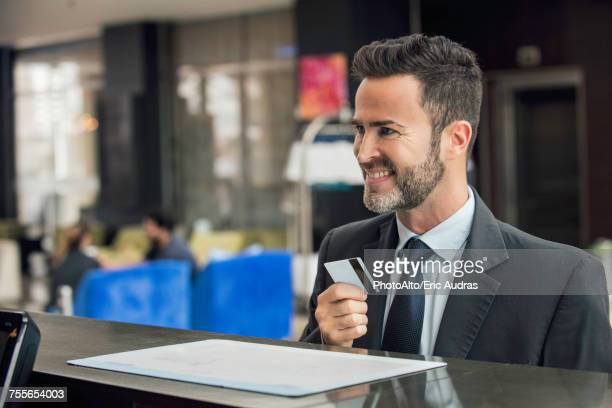 Businessman at customer service counter