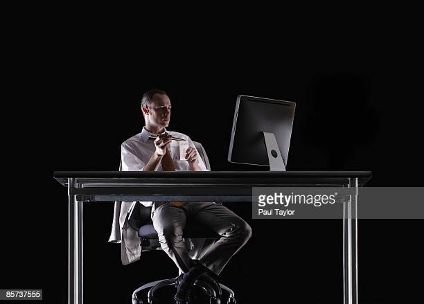 Businessman at desk with takeout