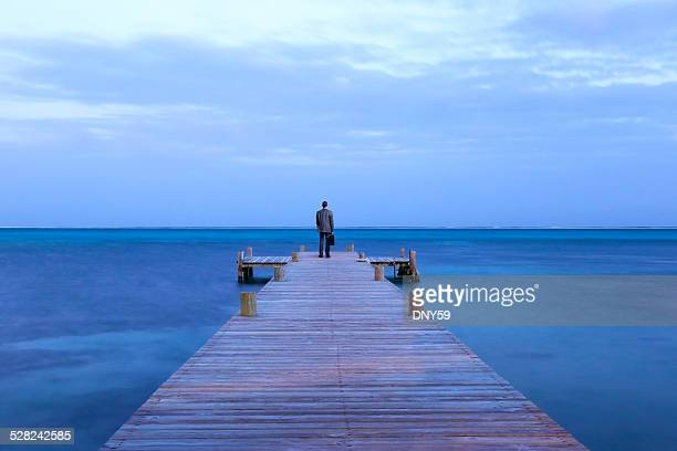 Businessman At End Of A Pier