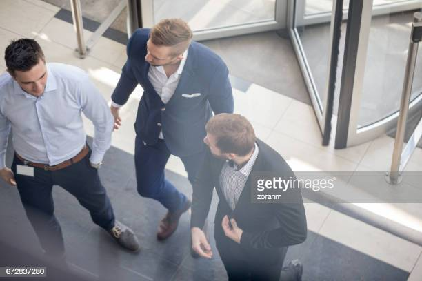 Businessman at entrance of an office building