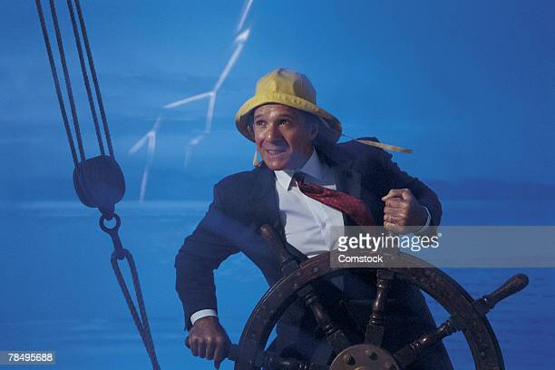 Businessman at helm of ship