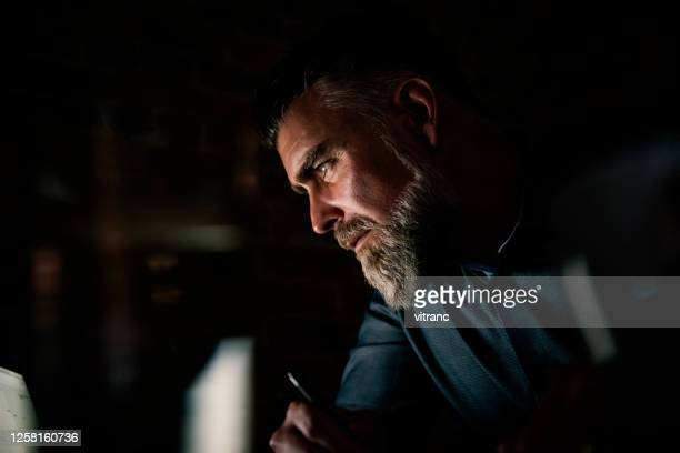 businessman at laptop with light reflection - working stock pictures, royalty-free photos & images