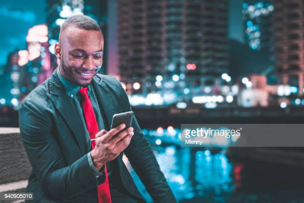 Businessman at Night checking Messages in Chicago