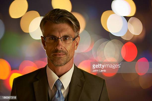 businessman at night - one man only stock pictures, royalty-free photos & images