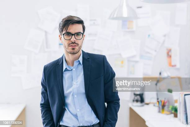 businessman at office - hands in pockets stock pictures, royalty-free photos & images