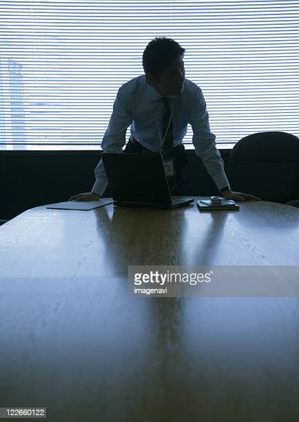 businessman at table in conference room - mission statement stock photos and pictures