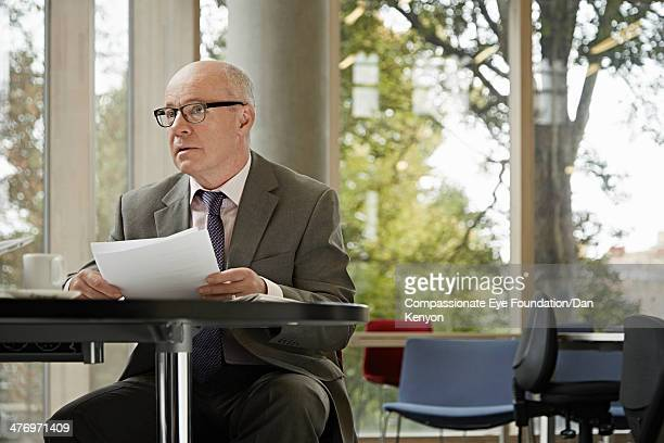 Businessman at table with documents
