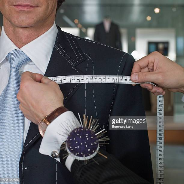 businessman at tailor's shop - tailor stock pictures, royalty-free photos & images