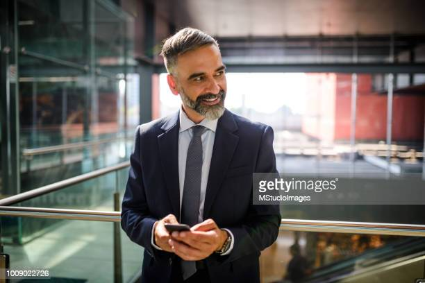 businessman at the airport. - 50 59 years stock pictures, royalty-free photos & images