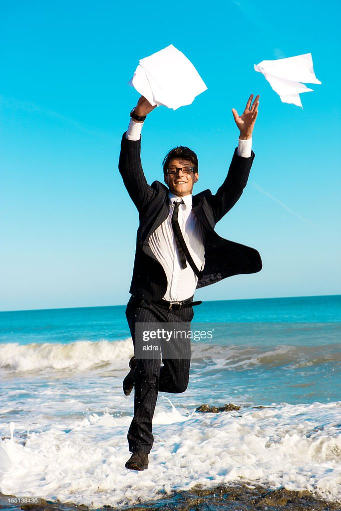 Businessman at the beach : Stock Photo