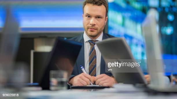 businessman at the head of the table - one man only stock pictures, royalty-free photos & images