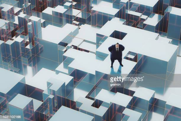 businessman at the top of the world - capitalism stock pictures, royalty-free photos & images