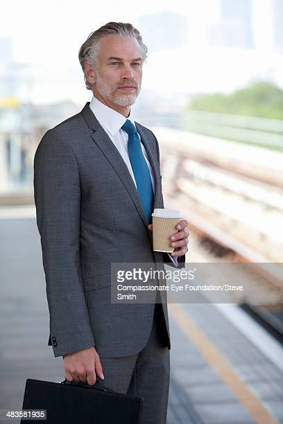 Businessman at train station