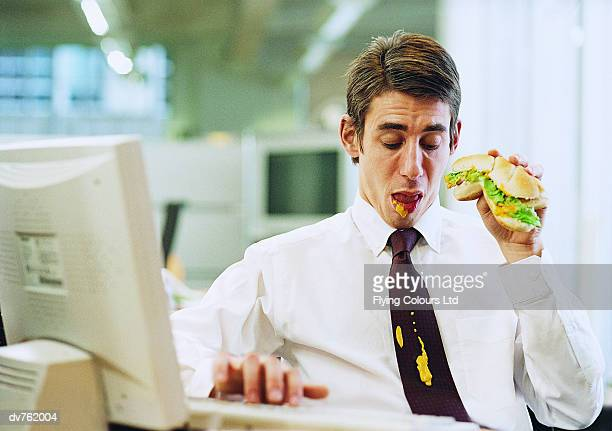 Businessman at Work Looking Down at His Mustard Stained Tie