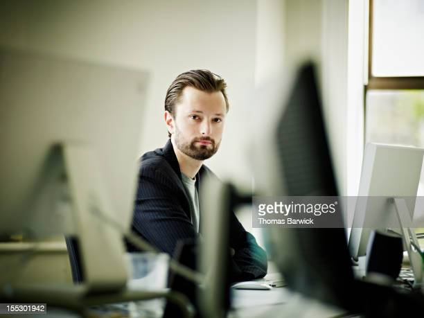 Businessman at workstation in front of computer