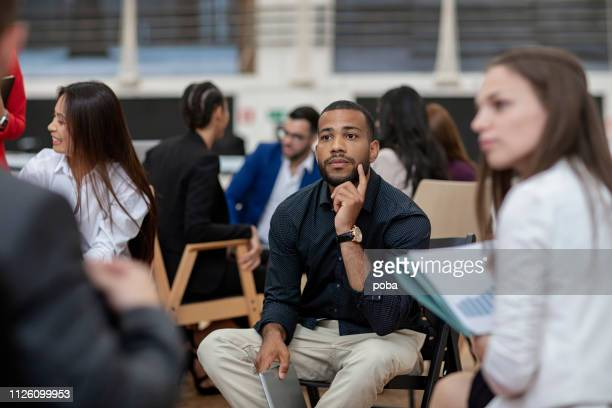 businessman attending a seminar - attending stock pictures, royalty-free photos & images