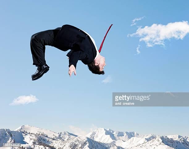Businessman Backflip in Winter Mountains
