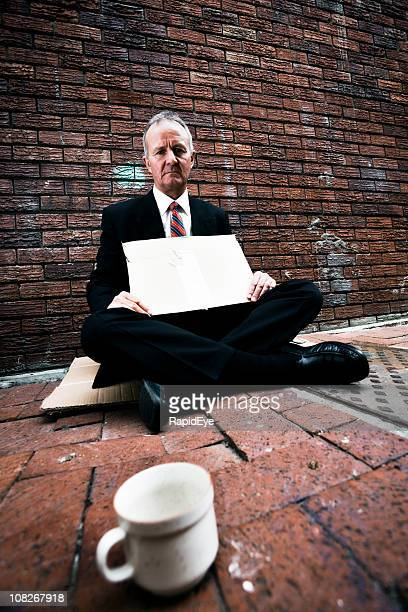 Businessman begging
