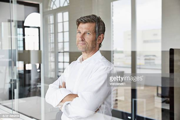Businessman behind glass pane in office