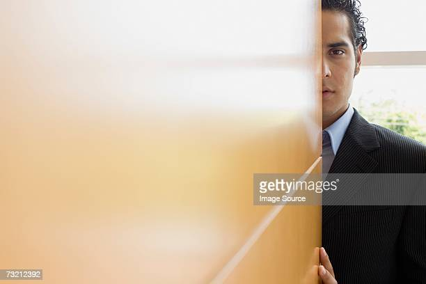 businessman behind wall - corner stock photos and pictures