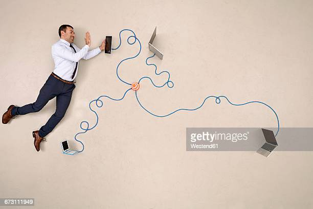 businessman being connected via tablet, waving - hovering stock pictures, royalty-free photos & images