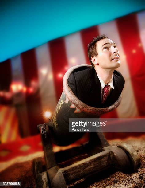 businessman being fired from cannon - cannon stock pictures, royalty-free photos & images