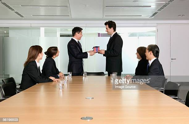Businessman being handed a gift