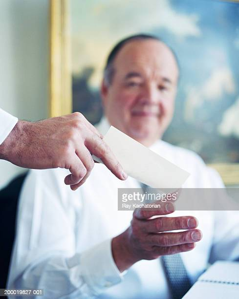 Businessman being handed note