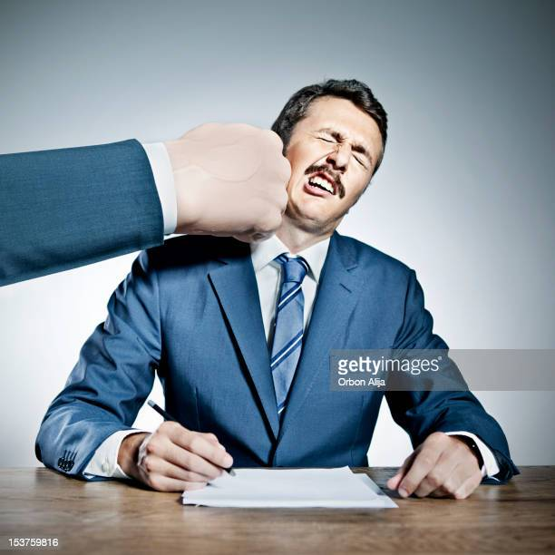 Businessman being punched