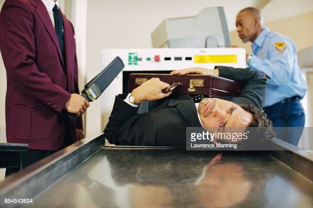 businessman being scanned at airport - metal detector security stock pictures, royalty-free photos & images