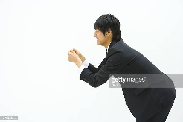 Businessman Bending Forward, Side View, Three Quarter Length, Copy Space