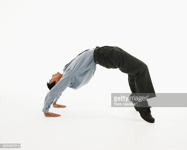 businessman bending over backwards - bending over backwards stock photos and pictures