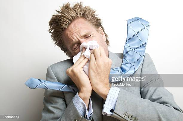 Businessman Blowing His Nose Forcefully