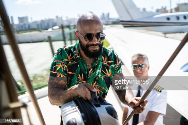 businessman boarding into a corporate jet - best sunglasses for bald men stock pictures, royalty-free photos & images