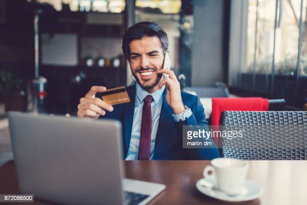 Businessman booking a trip with credit card