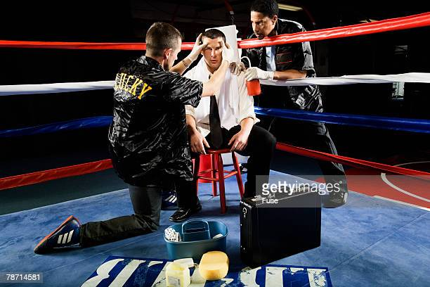 Businessman Boxer Being Treated Between Rounds