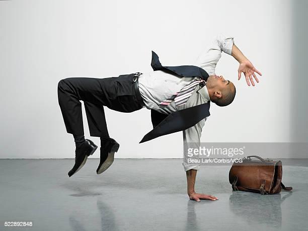 Businessman breakdancing