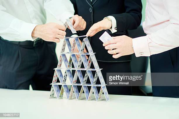 Businessman building house of cards