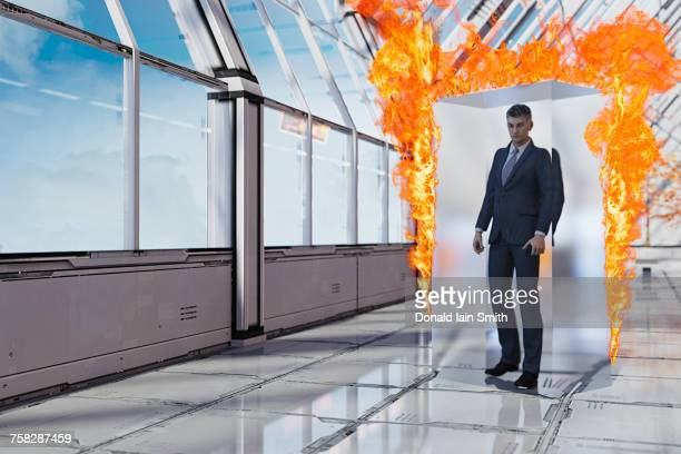 businessman burning in suspended animation - one mid adult man only stock pictures, royalty-free photos & images