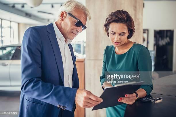Businessman buying a car