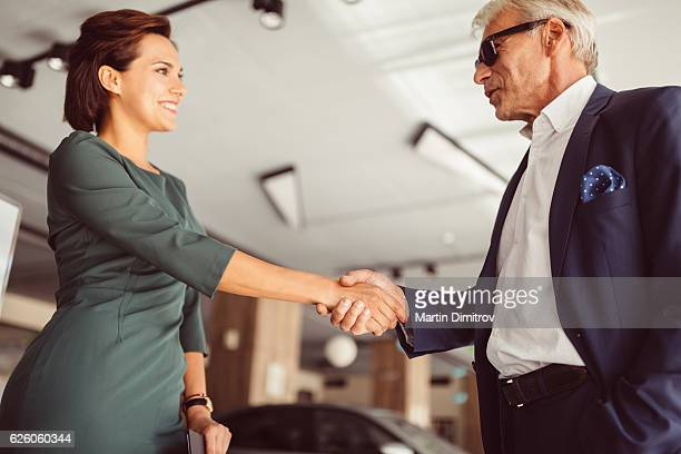 Businessman buying a new car