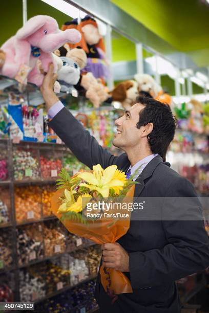 Businessman Buying Gifts at Store
