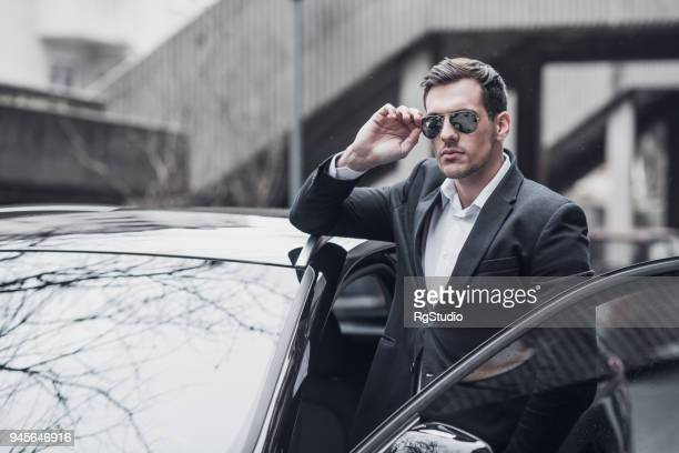 businessman by the business car - sports car stock pictures, royalty-free photos & images