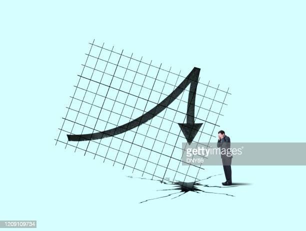 businessman can't watch plummeting sales or performance that has peaked - bear market stock pictures, royalty-free photos & images