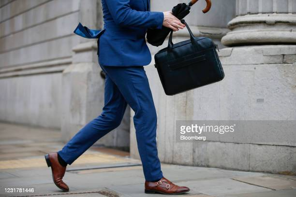 Businessman carrying a briefcase walks past the Bank of England the Bank of England in the City of London, U.K., on Thursday, March 18, 2021. The...