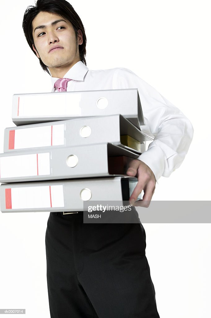 Businessman Carrying a Stack of Folders : Stock Photo